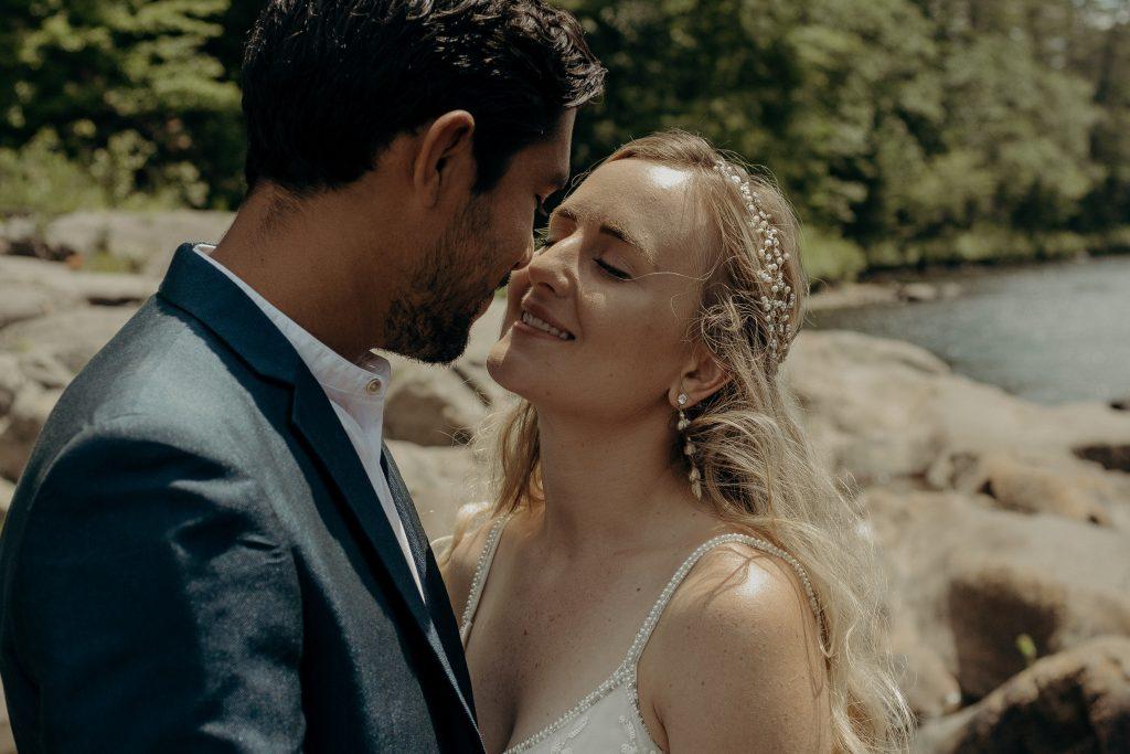 Couple kissing near lake