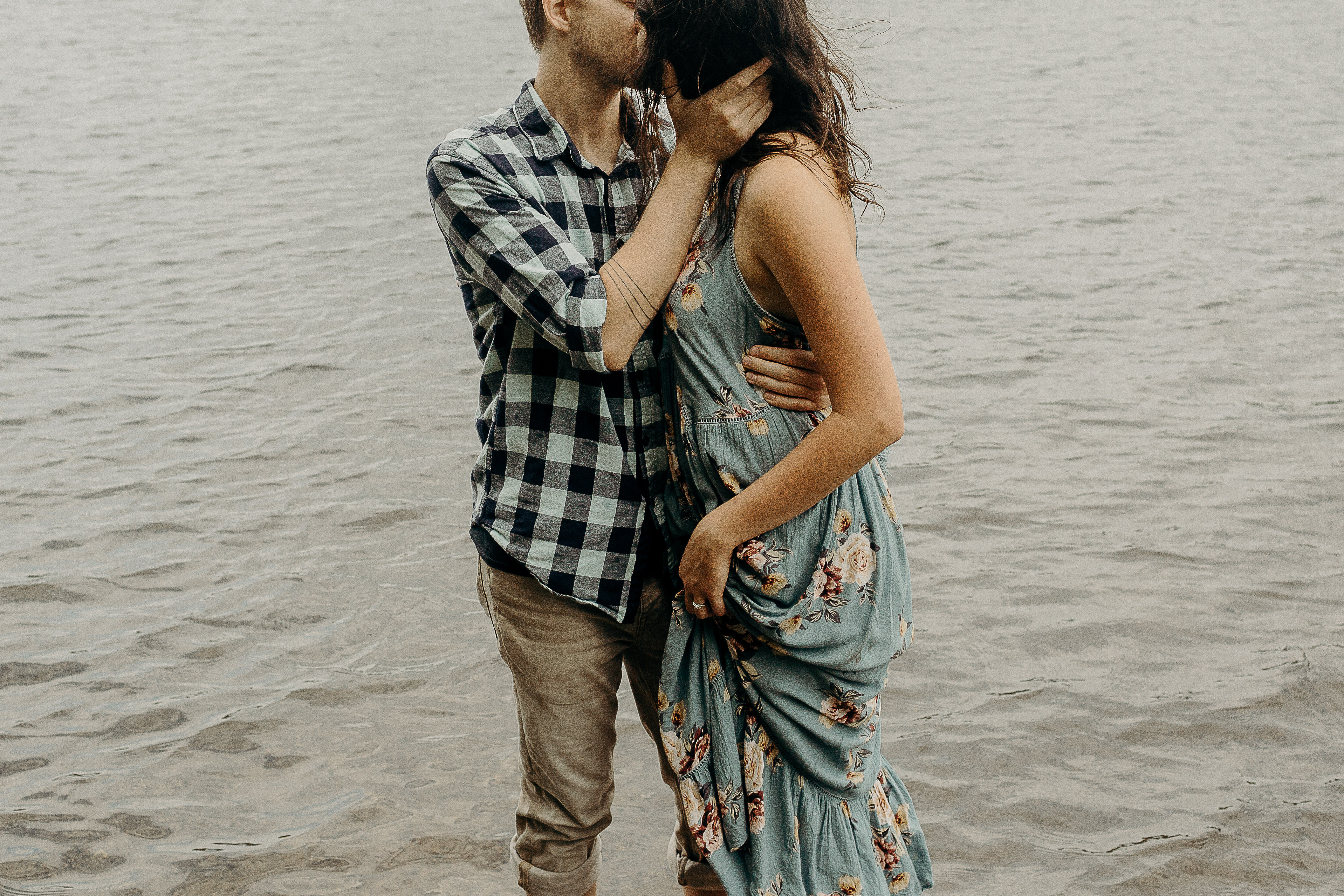 Couple kissing in a lake at Harriman State Park