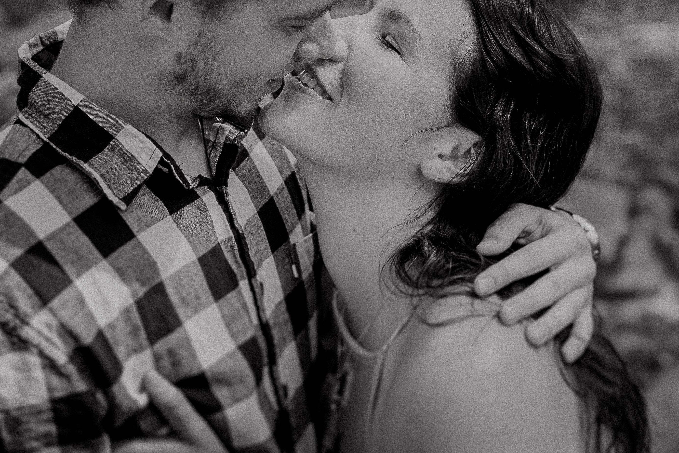 Girl and guy kissing